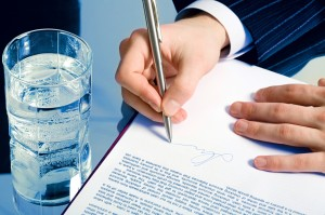 A businessman's hands signing a contract